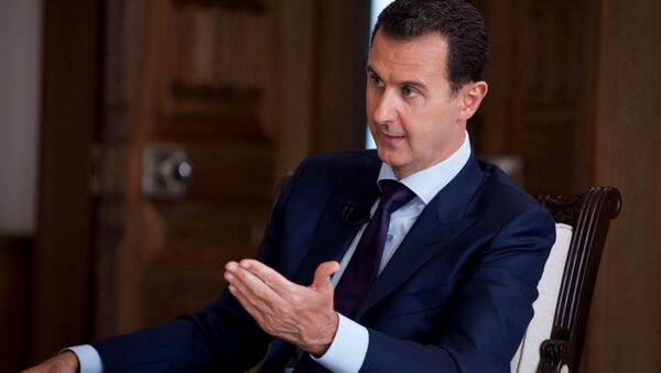 In this photo released on July 1, 2016, by the Syrian official news agency SANA, Syrian President Bashar Assad speaks during an interview with Australia's SBS news channel, in Damascus, Syria - Sputnik International