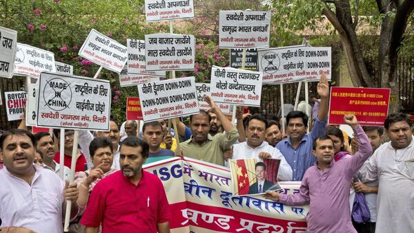 Activists of Swadeshi Jagaran Manch, a Hindu right wing organization promoting indigenous products, shout slogans during a protest near the Chinese embassy in New Delhi, India, Tuesday, June 28, 2016 - Sputnik International
