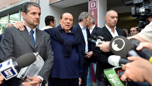 Italian tycoon and former prime minister Silvio Berlusconi talks with reporters as he leaves the hospital after a heart surgery in Milan, Italy July 5, 2016 - Sputnik International