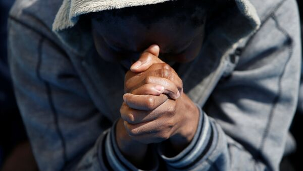 A migrant prays on the Migrant Offshore Aid Station (MOAS) ship Topaz Responder after being rescued around 20 nautical miles off the coast of Libya, June 23, 2016. - Sputnik International