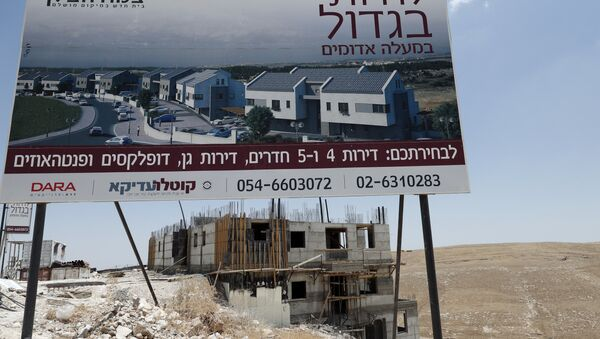 A picture taken on July 4, 2016, shows buildings under construction in the Israeli settlement of Maale Adumim, east of Jerusalem in the occupied West Bank. - Sputnik International