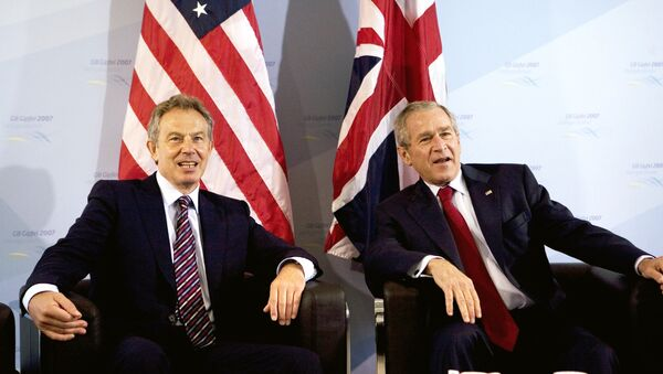 US President George W. Bush (R) and Britain's Prime Minister Tony Blair pose for photographers prior a bilateral meeting 07 June 2007 on the sidelines of the G8 Summit in Heiligendamm, northeastern Germany. - Sputnik International