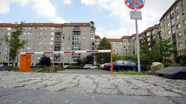 A parking lot and housing area in the German capital Berlin is seen on Tuesday, Sept. 14, 2004. Nothing on this parking area in the city's center reminds a viewer of former German Nazi-leader Adolf Hitler's bunker which was located here and the bunker's exit, where Hitler and his wife Eva were burned by aides after committing suicide. After WW II, East Germany built up a housing area on the site of the bunker. - Sputnik International