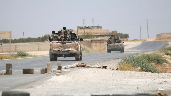 Syria Democratic Forces (SDF) ride vehicles along a road near Manbij, in Aleppo Governorate, Syria, June 25, 2016. - Sputnik International