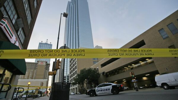 Police tape marks off the area where a shooting took place in downtown Dallas, Friday, July 8, 2016. - Sputnik International