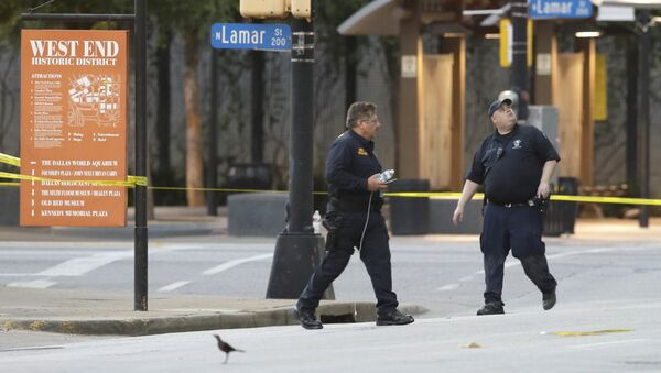 Investigators survey the area after a shooting in downtown Dallas, Friday, July 8, 2016. - Sputnik International