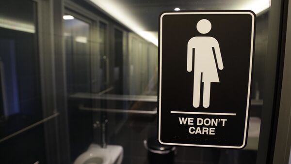 This Thursday, May 12, 2016, file photo, shows signage outside a restroom at 21c Museum Hotel in Durham, N.C. North Carolina is in a legal battle over a state law that requires transgender people to use the public restroom matching the sex on their birth certificate. - Sputnik International