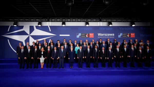 NATO heads of state and other leaders participate in a family photo at the NATO Summit in Warsaw, Poland July 8, 2016. - Sputnik International
