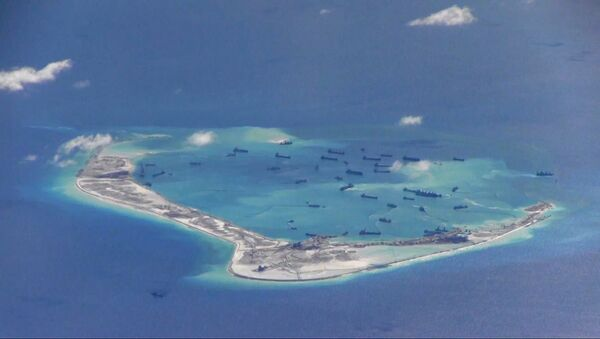 Chinese dredging vessels are purportedly seen in the waters around Mischief Reef in the disputed Spratly Islands in the South China Sea in this still image from video taken by a P-8A Poseidon surveillance aircraft provided by the United States Navy May 21, 2015. - Sputnik International