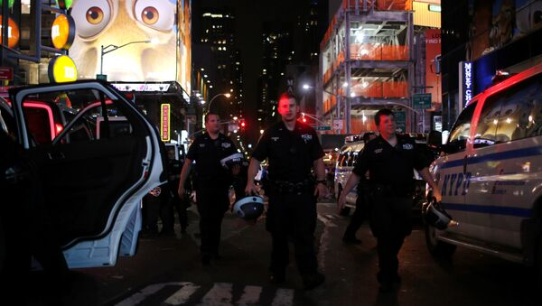 NYPD officers keep an eye on protesters as they go through Times Square taking part in a protest against the killing of Alton Sterling, Philando Castile and in support of Black Lives Matter during a march along Manhattan's streets in New York July 8, 2016. - Sputnik International
