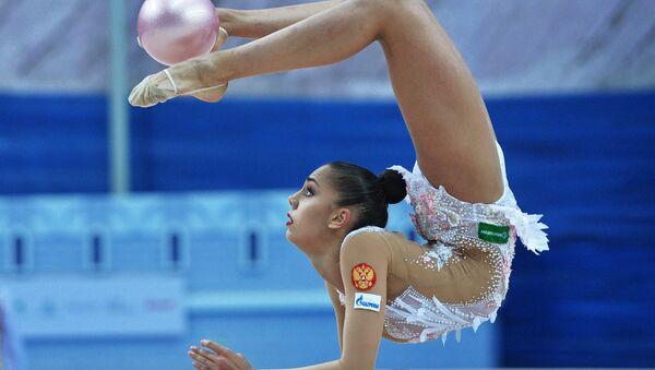 Russia's Margarita Mamun performs a ball routine during individual all-around at the 2016 Rhythmic Gymnastics World Cup Series in Kazan, Russia - Sputnik International