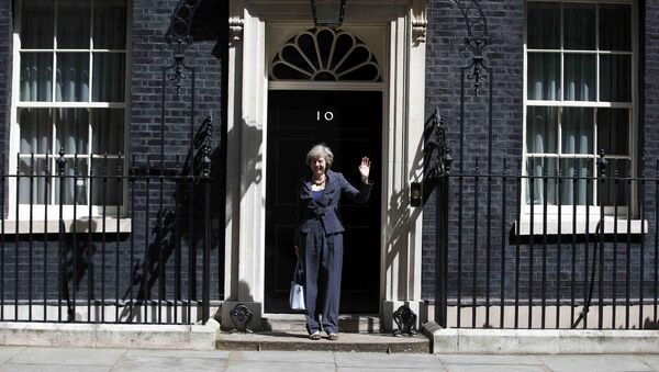 Britain's Home Secretary Theresa May, who is due to take over as prime minister on Wednesday, waves as she leaves after a cabinet meeting at number 10 Downing Street, in central London, Britain July 12, 2016 - Sputnik International