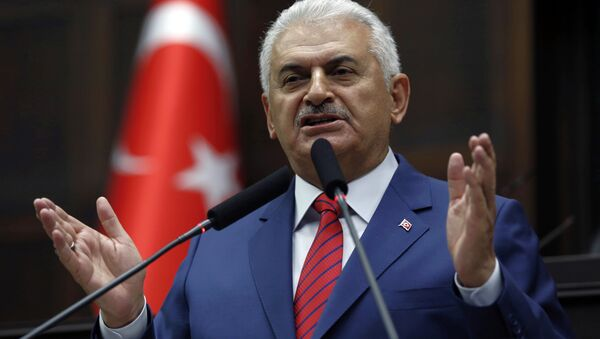Turkey's Prime Minister Binali Yildirim addresses lawmakers at the parliament a day after he announced the details of an agreement reached with Israel. - Sputnik International