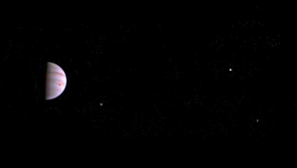 NASA's Juno probe of Jupiter captured this image on 10 July 2016, less than a week after entering orbit around the giant planet. - Sputnik International