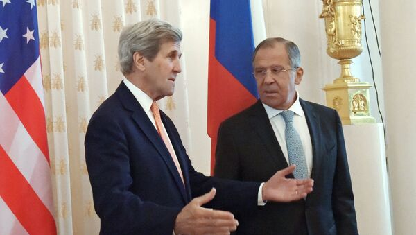 Russian Foreign Minister Sergei Lavrov, right, and US Secretary of State John Kerry at a meeting in Moscow. - Sputnik International