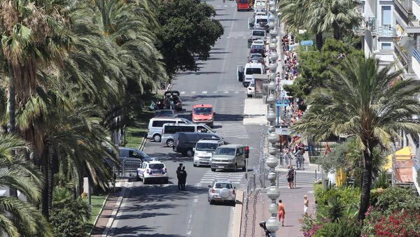 A photo taken on July 15, 2016 shows a police barricade set up at the site in Nice where a gunman smashed a truck into a crowd of revellers celebrating Bastille Day, killing at least 84 people. - Sputnik International