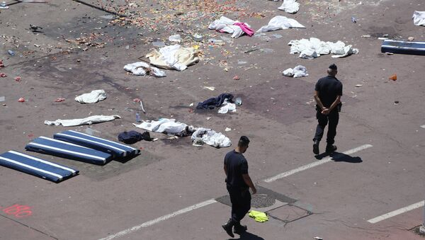 French gendarmes walk past clothes and mattresses at the site of the deadly attack on the Promenade des Anglais seafront in the French Riviera city of Nice on July 15, 2016, after a gunman smashed a truck through a crowd celebrating Bastille Day, killing at least 84 and injuring dozens - Sputnik International