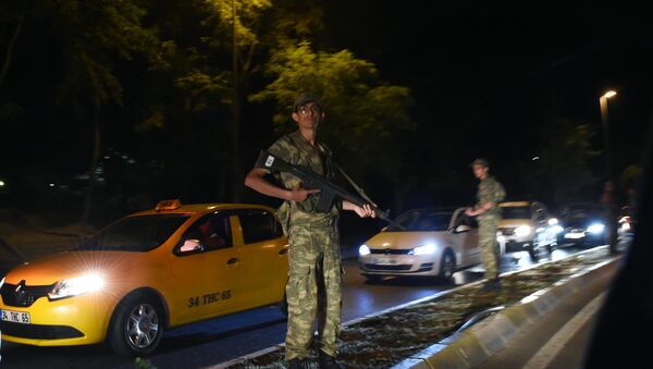 Turkish security officer stands on guard on the side of the road on July 15, 2016 in Istanbul, during a security shutdown of the Bosphorus Bridge. - Sputnik International