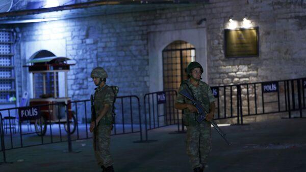 Turkish military stand guard near the the Taksim Square in Istanbul - Sputnik International