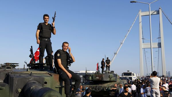 Policemen stand atop military armored vehicles after troops involved in the coup surrendered on the Bosphorus Bridge in Istanbul, Turkey July 16, 2016. - Sputnik International