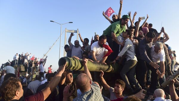 Supporters of Tukish President Tayyip Erdogan celebrate after soldiers involved in the coup surrendered on the Bosphorus Bridge in Istanbul, Turkey July 16, 2016 - Sputnik International