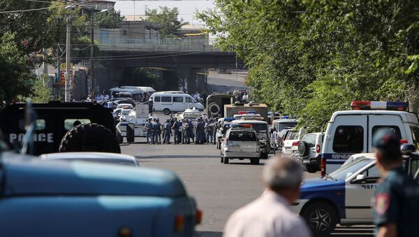 Policemen block a street after group of armed men seized a police station along with an unknown number of hostages, according the country's security service, in Yerevan, Armenia, July 17, 2016. - Sputnik International