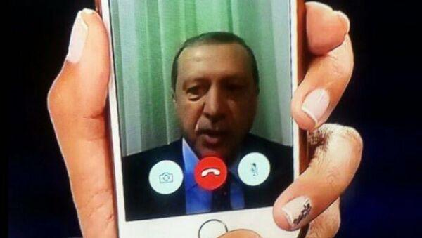 Telephone statement by Turkish President Recep Tayyip Erdogan, shown on the news on TV at an Istanbul home. - Sputnik International
