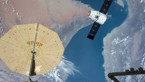 The SpaceX Dragon spacecraft nears the International Space Station during the CRS-8 mission to deliver experiments including two microbial investigations. - Sputnik International