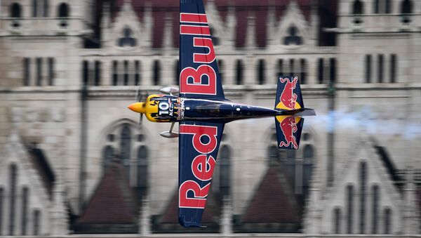 US Kirby Chambliss of the Team Chambliss with his Edge 540 V3 plane competes during the Red Bull Air Race World Championship over the river Danube in Budapest on July 17, 2016 - Sputnik International
