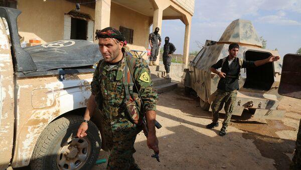 Kurdish and Arab fighters advance into the Islamic State (IS) jihadist's group bastion of Manbij, in northern Syria (File) - Sputnik International