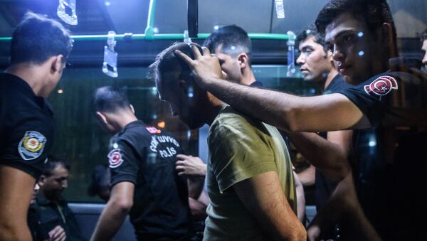 Turkish anti riot police officers detain a Turkish soldier who allegedly took part in a military coup as they are leaving in a bus the courthouse at Bakirkoy district in Istanbul on July 16, 2016 - Sputnik International