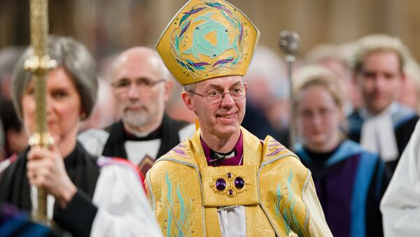 The Archbishop of Canterbury, Justin Welby (C) walks in procession after being Enthroned in Canterbury Cathedral in Canterbury on March 21, 2013. - Sputnik International