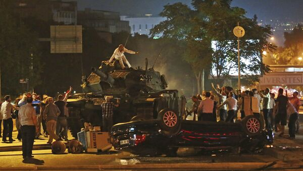 In this July 16, 2016, file photo, tanks move into position as Turkish people attempt to stop them in Ankara, Turkey - Sputnik International
