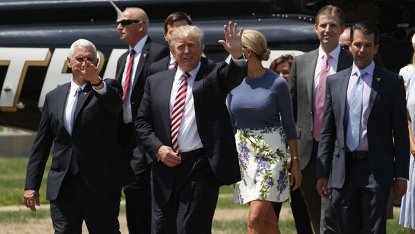 Republican U.S. presidential nominee Donald Trump (C) walks with vice presidential candidate Mike Pence (L) and family members after arriving for an event on the sidelines of the Republican National Convention in Cleveland, Ohio, U.S., July 20, 2016 - Sputnik International