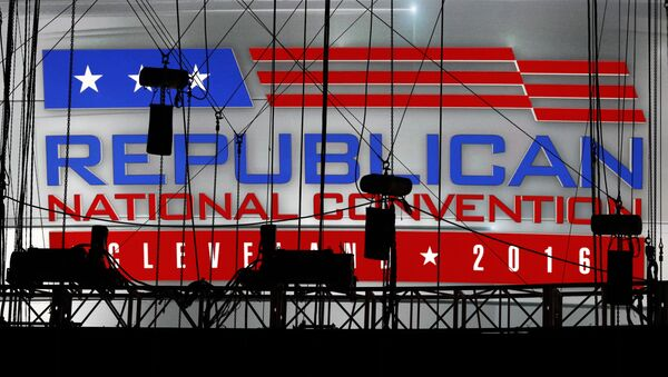 A Republican National Convention logo is seen though silhouetted production equipment on a huge video screen at Quicken Loans Arena for the Republican National Convention. - Sputnik International