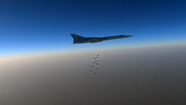 A file photo showing a Russian Air Force long-range bomber TU-22M3 seen here bombing Daesh in Syria - Sputnik International