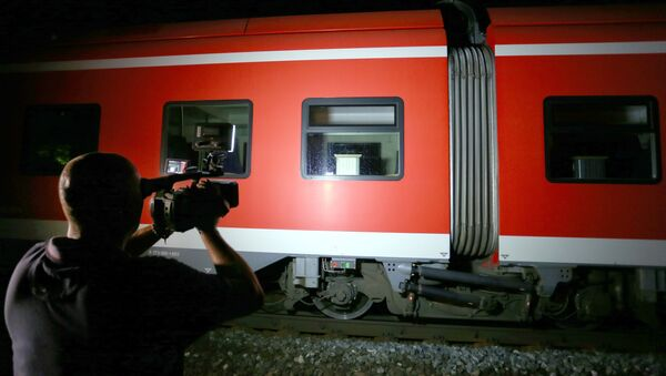 Cameraman films trains on which a man attacked passengers in Germany - Sputnik International