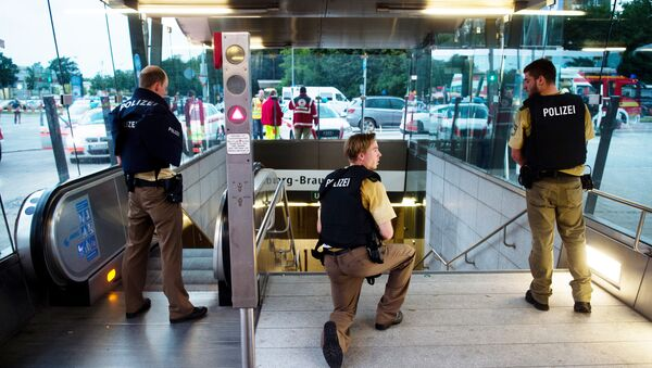 Police secures the entrance to a subway station near a shopping mall where a shooting took place on July 22, 2016 in Munich - Sputnik International