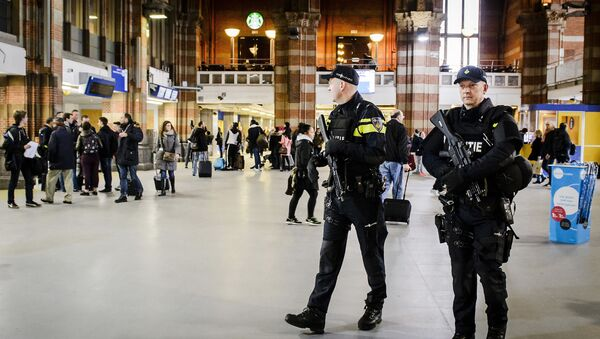 Dutch officers carry out extra patrols at the Central Station in Amsterdam, The Netherlands, 22 March 2016 - Sputnik International