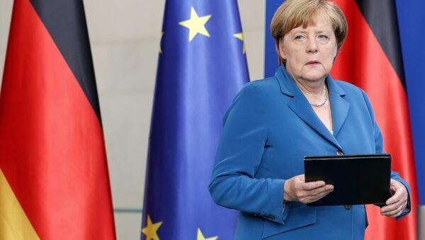 German Chancellor Angela Merkel arrives for a statement in Berlin, Germany, Saturday, July 23, 2016 on the Munich attack. - Sputnik International