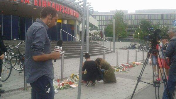 Flowers outside the Olympia shopping mall, where yesterday's shooting rampage started, in Munich, Germany - Sputnik International