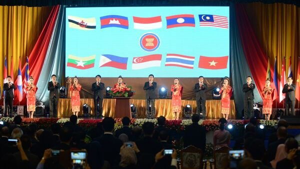 Delegates and performers sing the ASEAN anthem during the opening ceremony of the Association of Southeast Asian Nations' (ASEAN) 49th annual ministerial meeting in Vientiane on July 24, 2016. - Sputnik International
