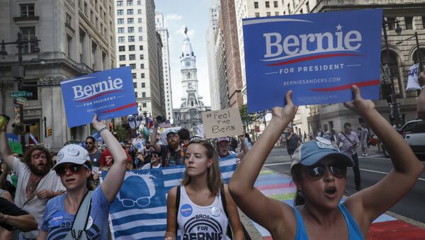Supporters of Sen. Bernie Sanders, I-Vt., march during a protest in downtown on Sunday, July 24, 2016, in Philadelphia. The Democratic National Convention starts Monday in Philadelphia. - Sputnik International