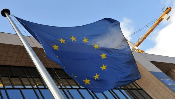 EU flag is seen in front of the EU Commission Headquarters in Brussels. (File) - Sputnik International