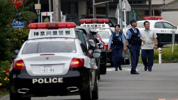 Police officers investigate near a facility for the disabled, where a deadly attack by a knife-wielding man took place, in Sagamihara, Kanagawa prefecture, Japan, July 26, 2016. - Sputnik International