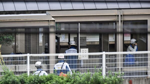 Rescue workers are seen in a facility for the disabled, where a deadly attack by a knife-wielding man took place, in Sagamihara, Kanagawa prefecture, Japan, in this photo taken by Kyodo July 26, 2016. - Sputnik International
