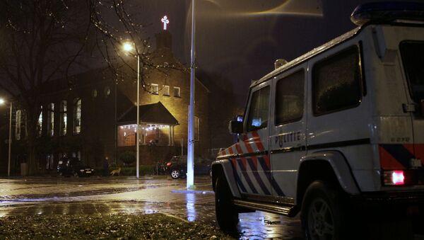 A police vehicle guards the Coptic church, rear, in Amsterdam, Netherlands (File) - Sputnik International