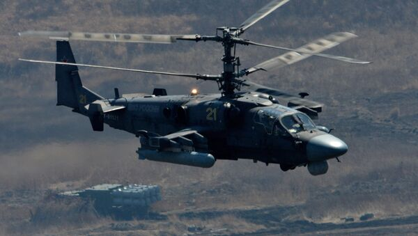 Ka-52 Alligator attack helicopter and Bal coastal missile system during bilateral drill of the Pacific Fleet - Sputnik International