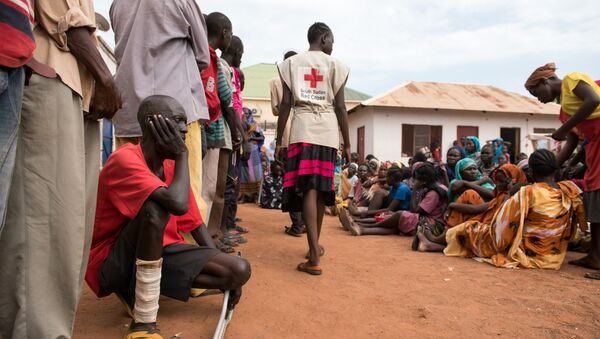 This photo taken on July 1, 2016 shows men and women waiting to be registered as displaced persons in a South Sudan Redcross compound in Wau, South Sudan - Sputnik International