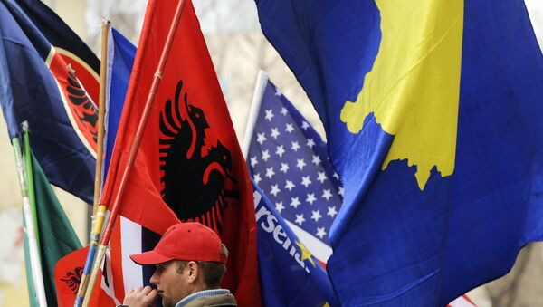 A Kosovo Albanian man sells flags in Pristina on February 16, 2011 in preparation for the third anniversary of Kosovo's declaration of independence - Sputnik International